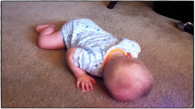 son with down syndrome lying down sleeping crawling