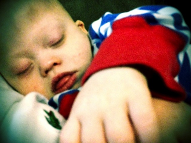 adorable baby down syndrome sleeping daddy