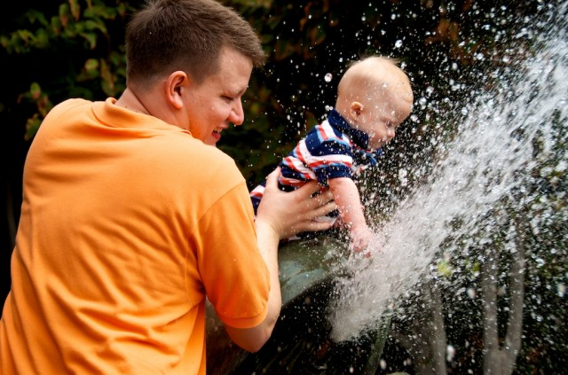 father son baby down syndrome playing in water