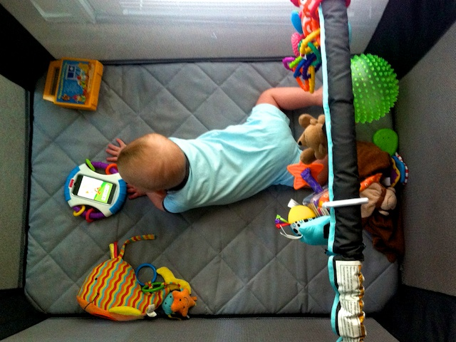 baby down syndrome playing pack n play iphone