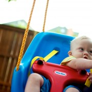 baby-down-syndrome-playing-swing 1