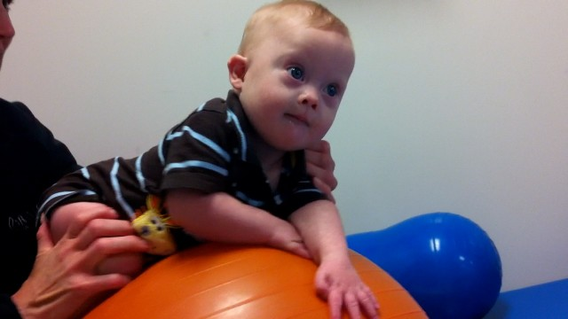 baby doing physical therapy down syndrome