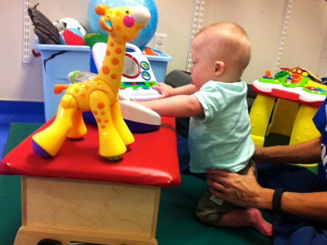 baby down syndrome physical thearpy kneeling