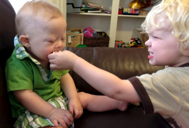 down syndrome baby eating cookies with friends