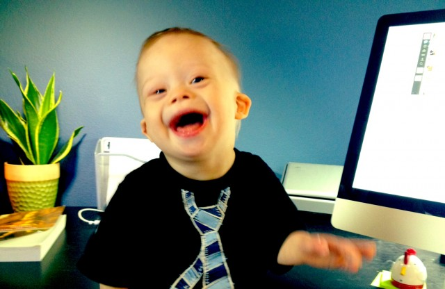 down syndrome boy laughing