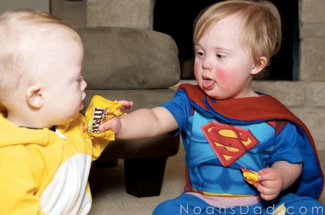children babies sharing candy