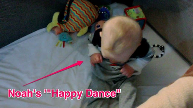 baby with down syndrome doing happy dance