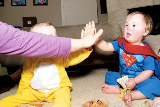 celebrating down syndrome kids high five fun playing