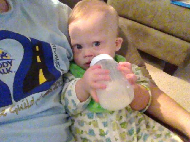 down syndrome baby drinking from bottle