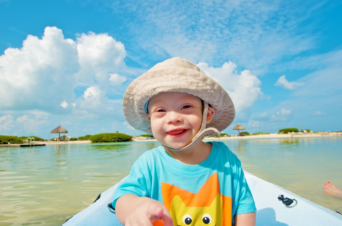 baby on boat captain florida cute kid down syndrome