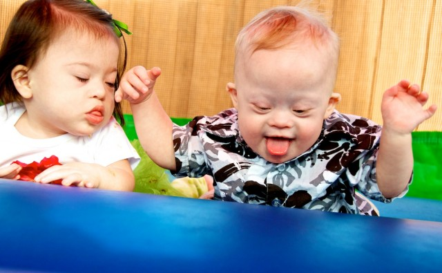 down syndrome babies kids playing playing bounce house