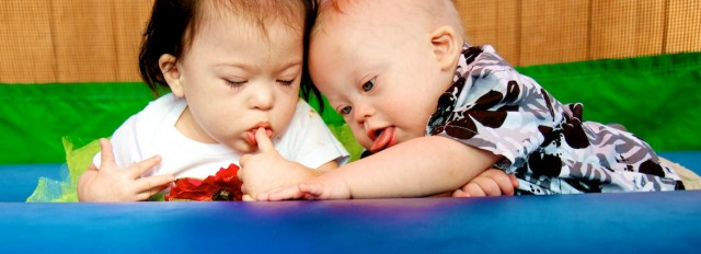 down syndrome baby babies playing bounce house