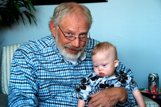 supportive grandfather down syndrome baby
