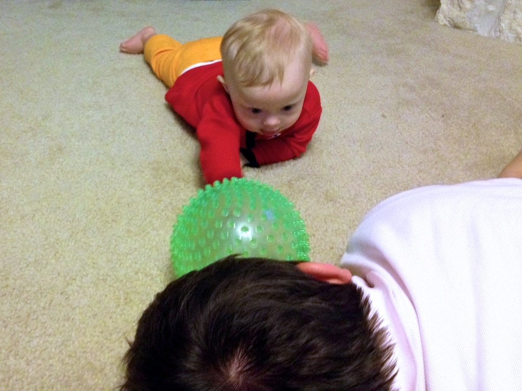 baby with down syndrome interacting with parents