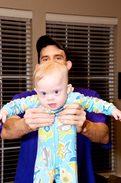 Uncle holding nephew down syndrome first thanksgiving
