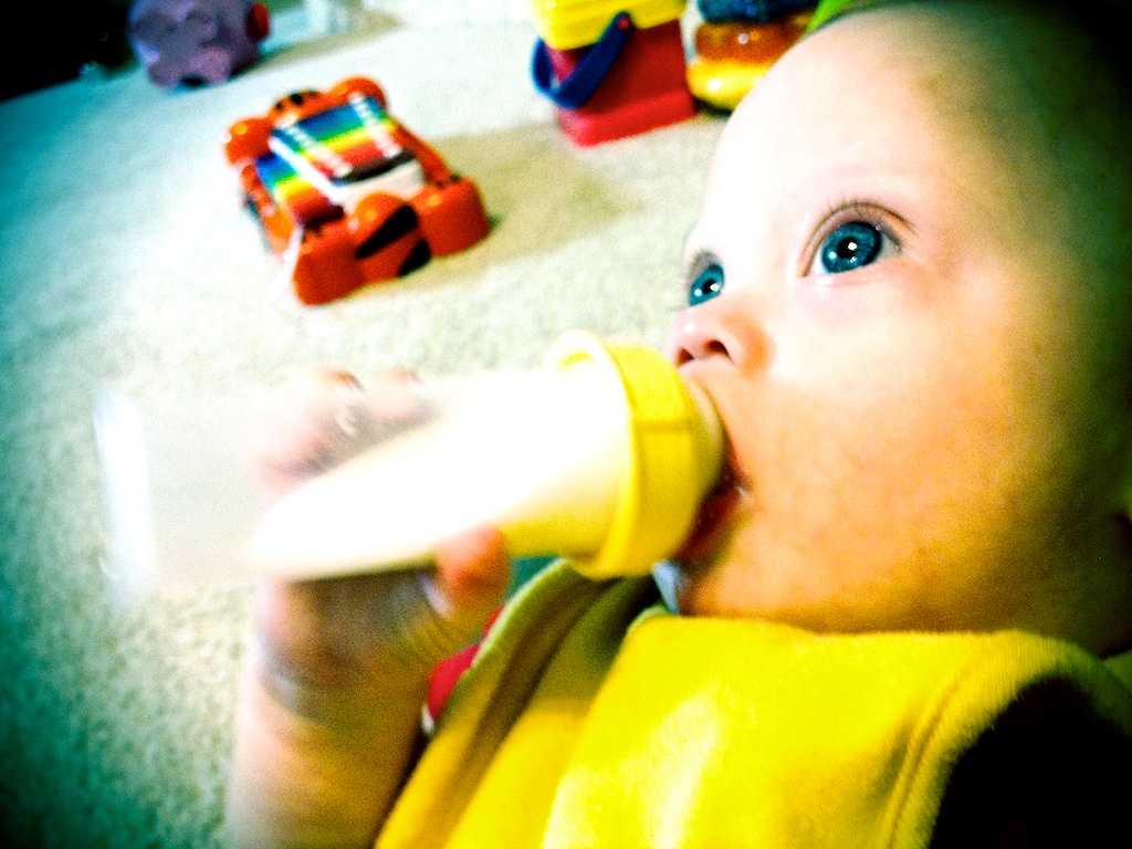 down syndrome baby holding bottle by himself without help