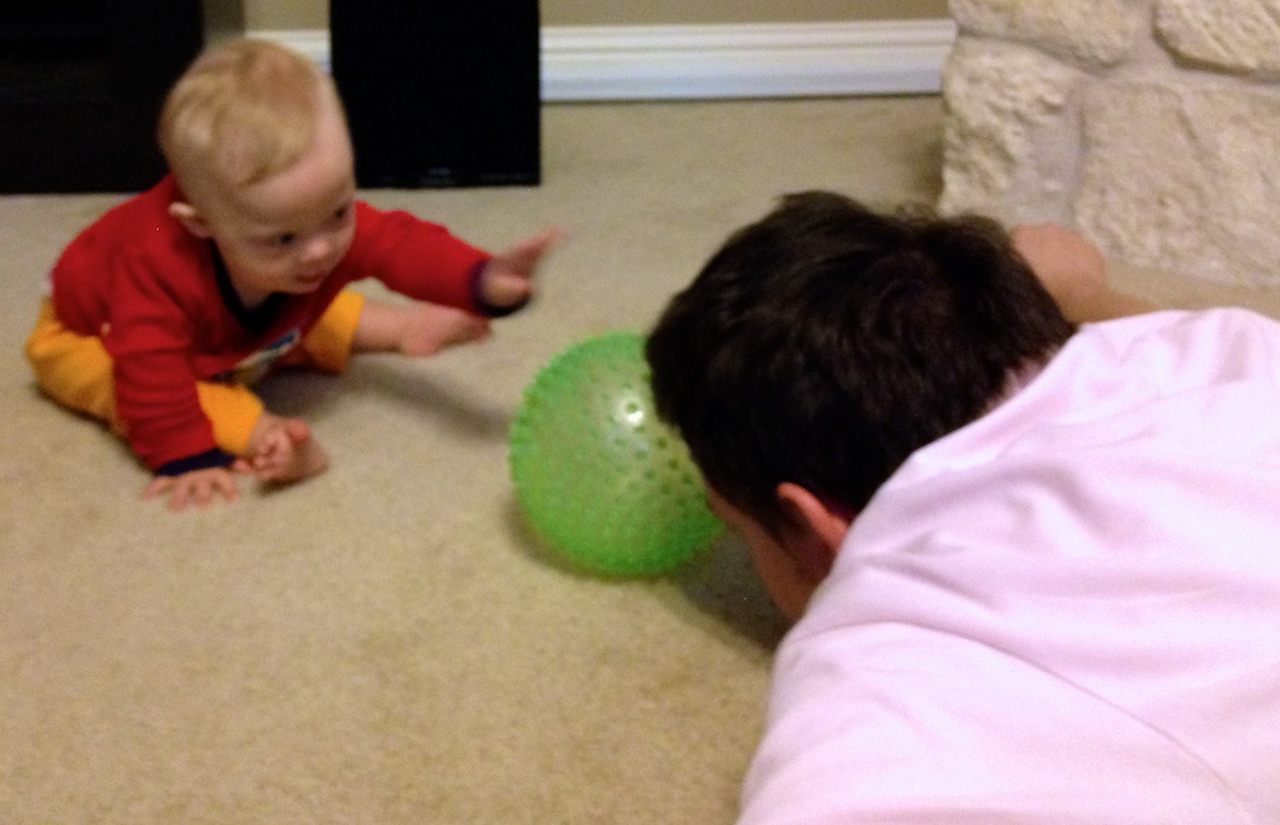 child with down syndrome play with dad