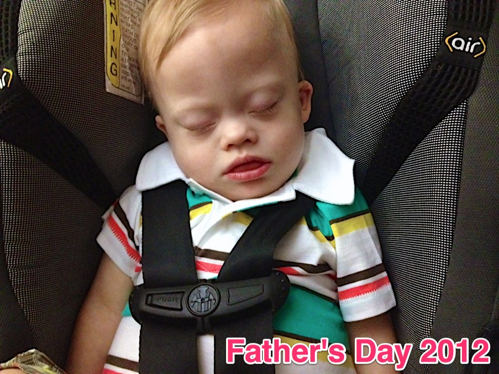 sleepy baby sleeping in car seat down syndrome
