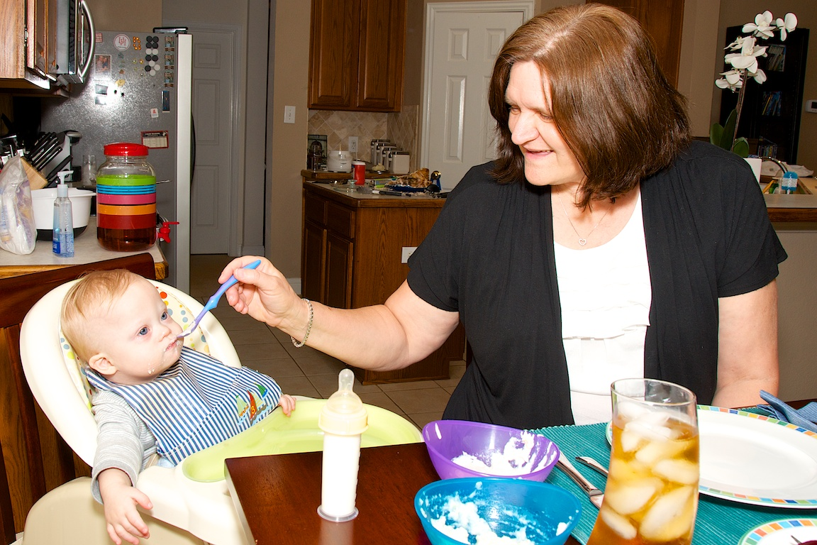 grandma feeding grandson with down syndrome first thanksgiving