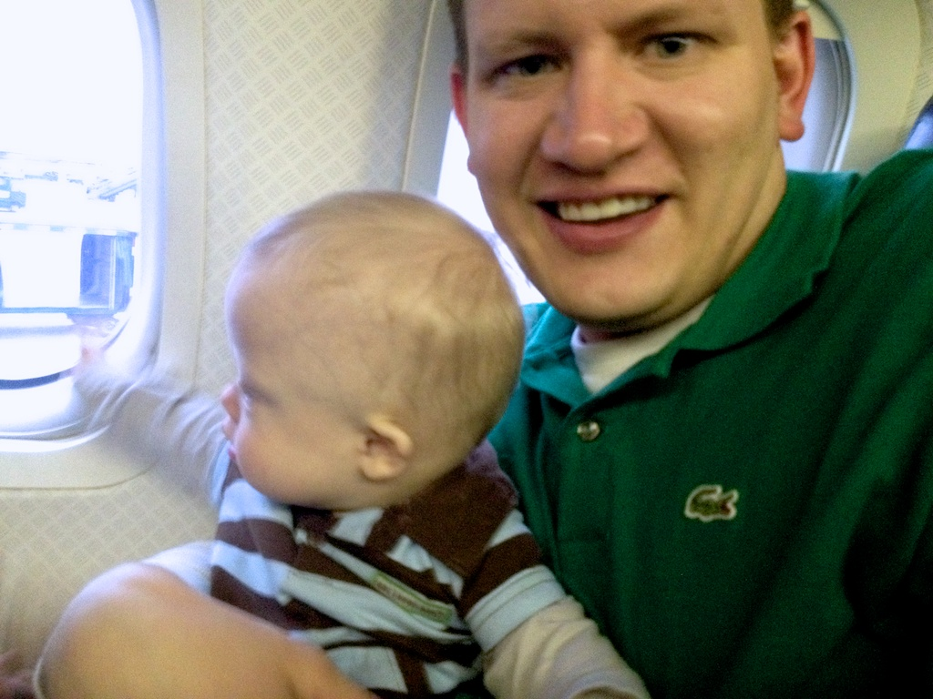 father and son with down syndrome on airplane