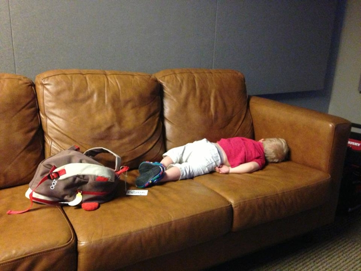 down syndrome baby at work with dad sleeping on couch