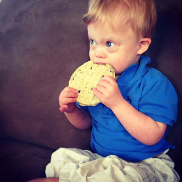 cute-kid-with-down-syndrome-eating-eggo-waffle