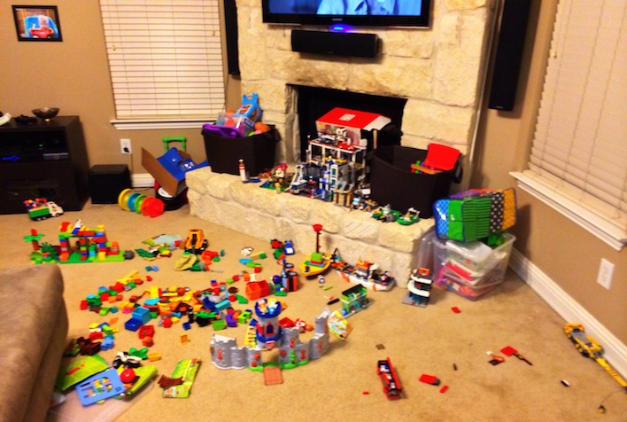 living room full of toys duplo blocks down syndrome