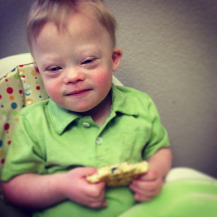 new-born-with-down-syndrome-self-feeding
