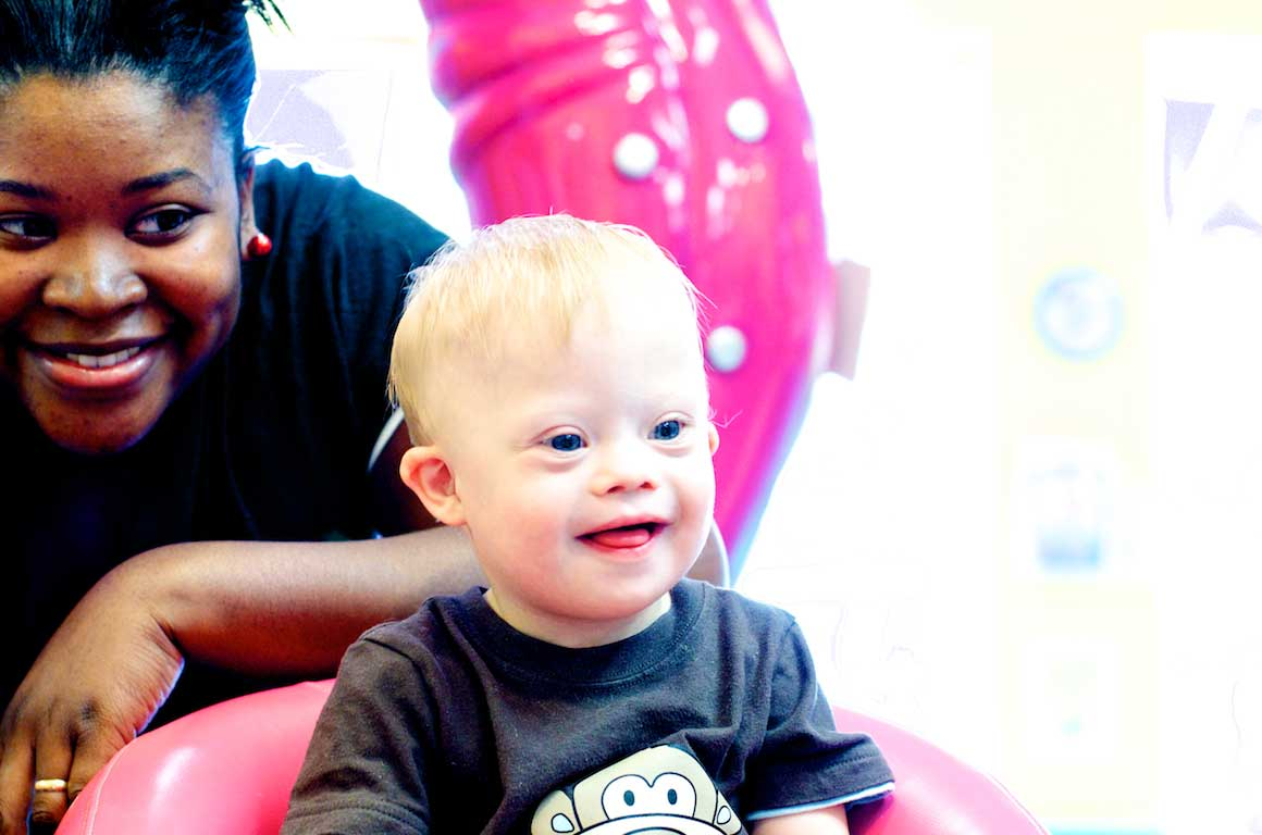 one year old special needs child getting haircut