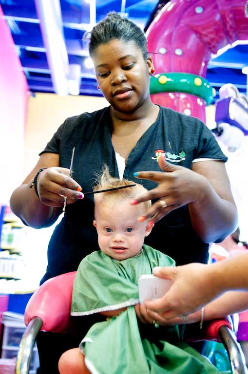 down syndrome child getting haircut special needs