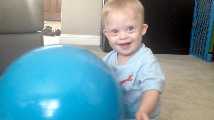 when does a child roll push a ball back and forth
