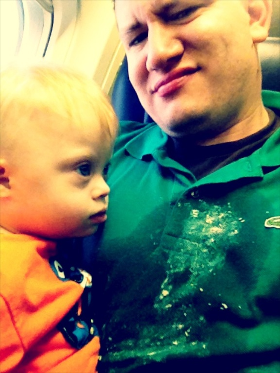 baby throwing up vomiting on plane parent