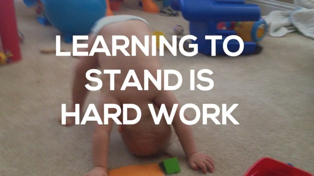 baby with down syndrome learning to stand up