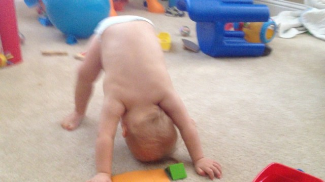 child down syndrome learning to stand