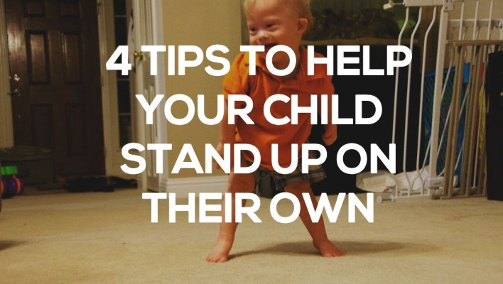 how to help child stand up on their own