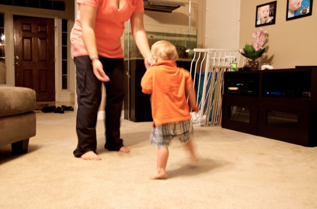 baby with down syndrome walking to mom mommy
