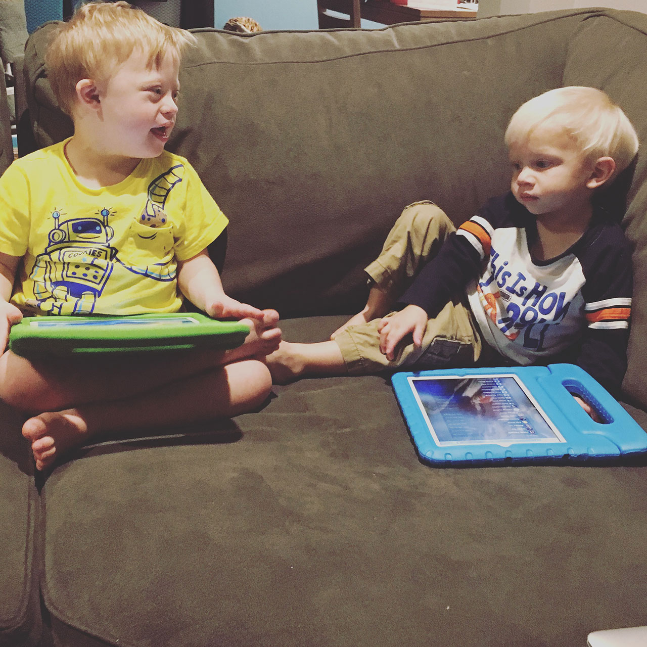 child with down syndrome using ipad