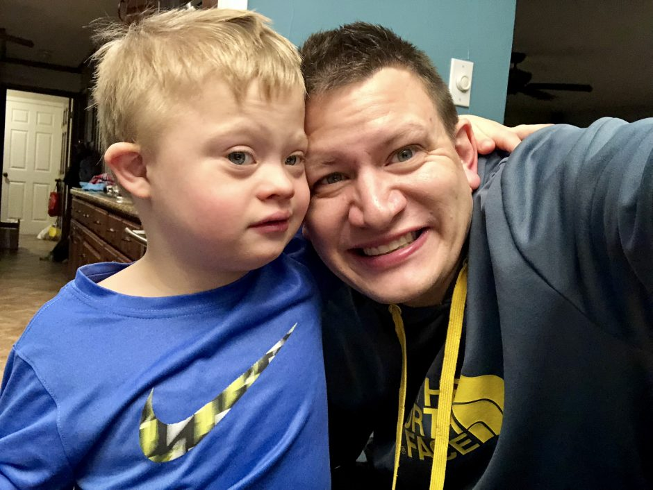 boy with down syndrome and his dad