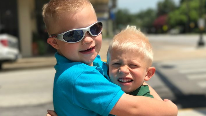 brother with down syndrome-hugging