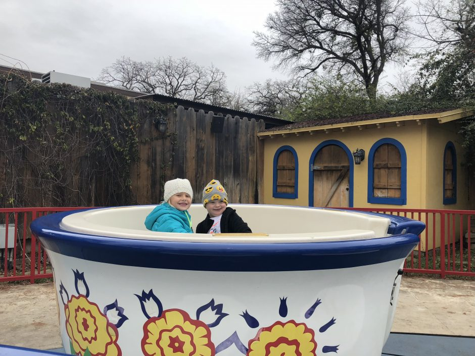 child with down syndrome riding tea cups at six flags