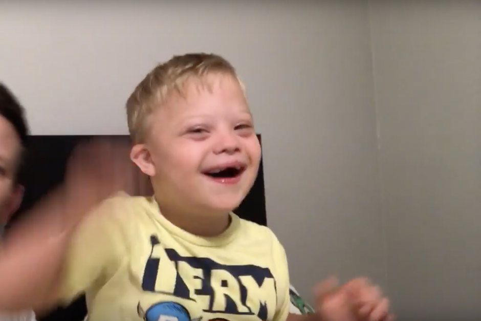 down syndrome child singing mickey mouse club house