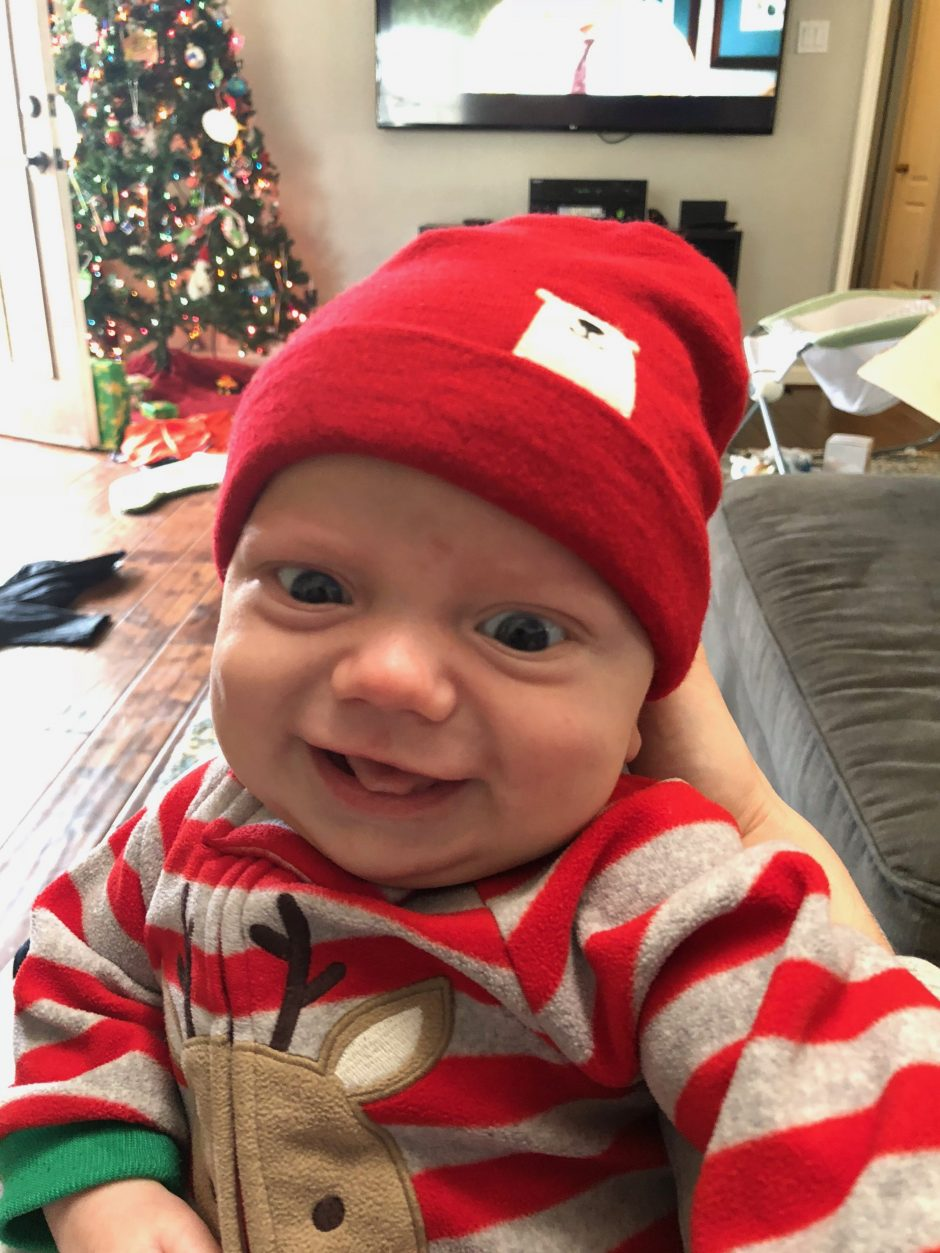 baby's first Christmas younger brother of a child with Down syndrome