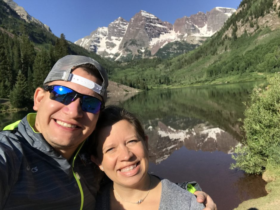 husband and wife in front of maroon bells aspen colorado