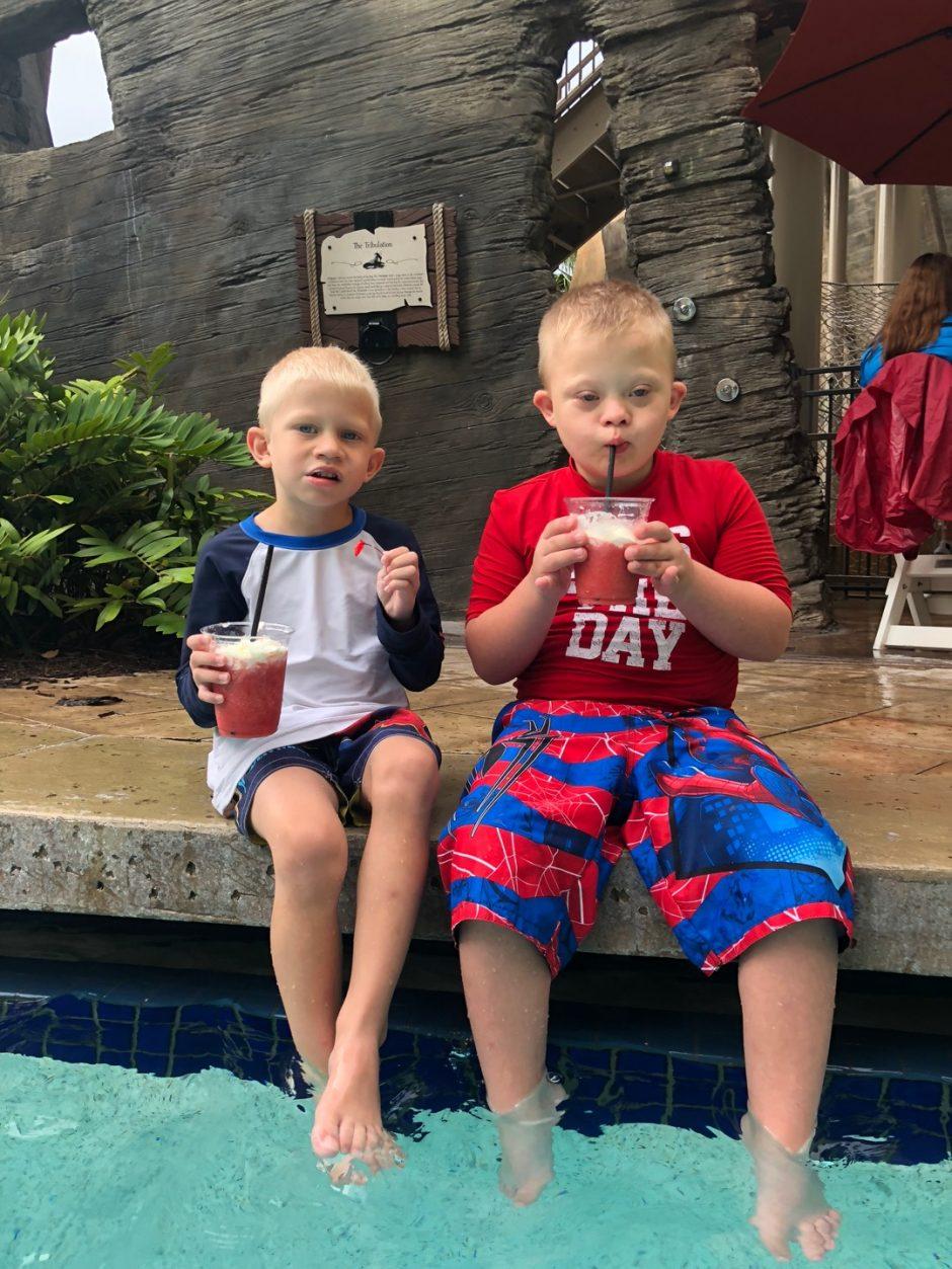 kids having a drink wyndham grand pool