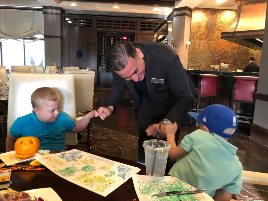 manager greeting kids deep blue seafood grille