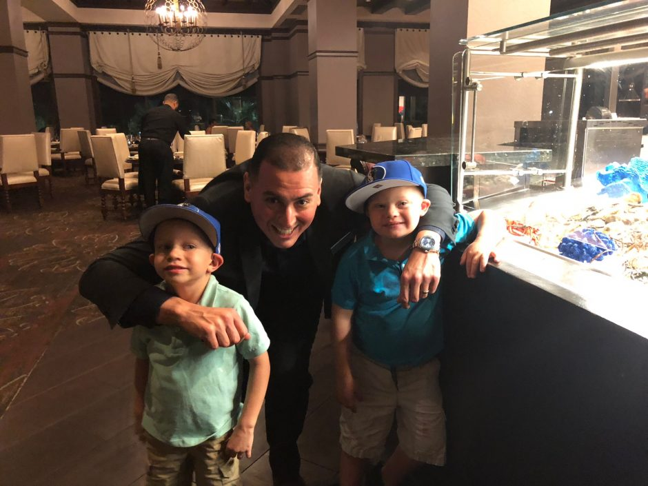 restaurant manager with child with down syndrome